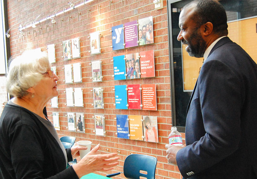 Patron talking with Chief Librarian Marcellus Turner