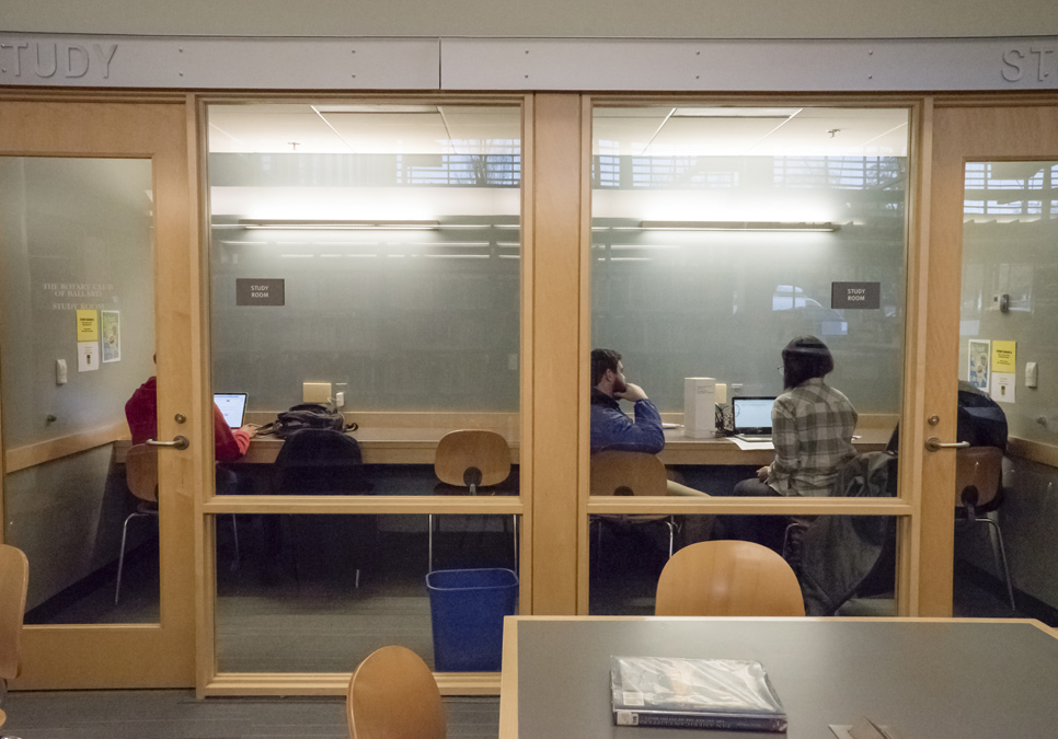 Library patrons using the study room area at the Ballard Branch