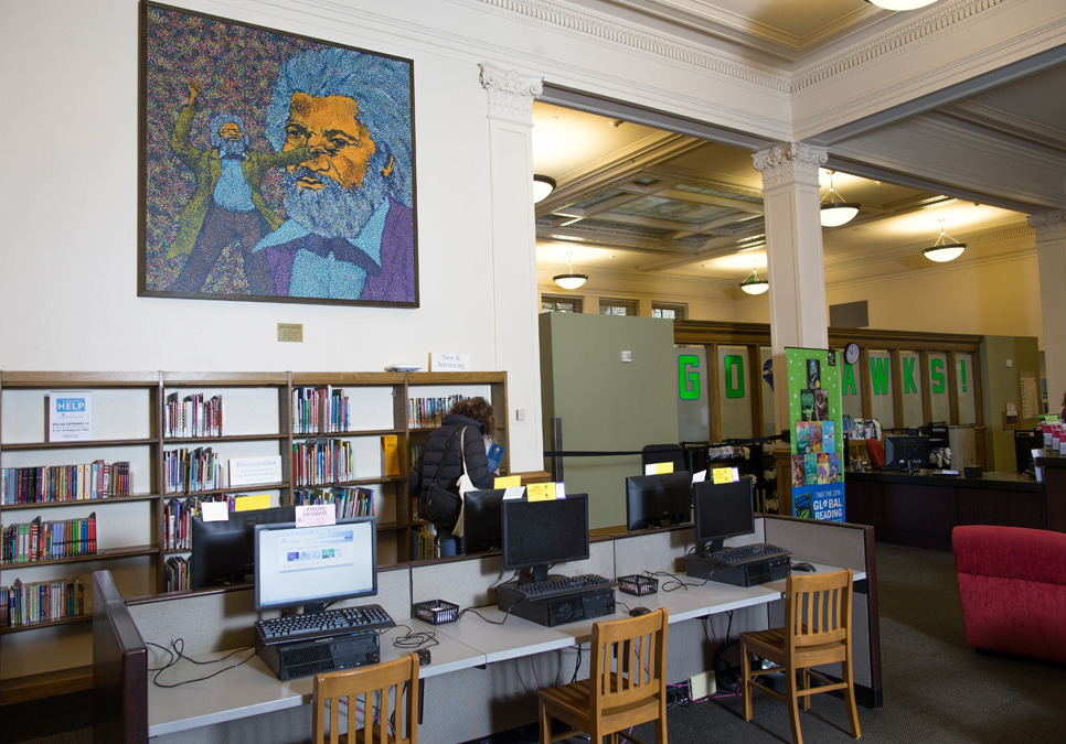 Library patrons in seating area at the Douglass-Truth Branch