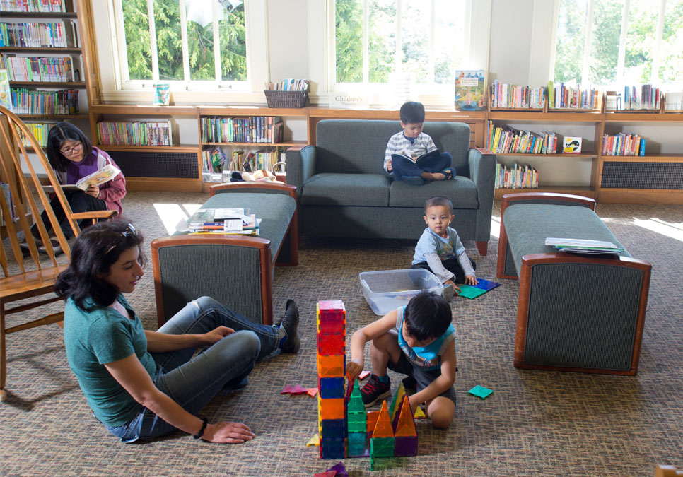 Children playing in children's area at the Green Lake Branch