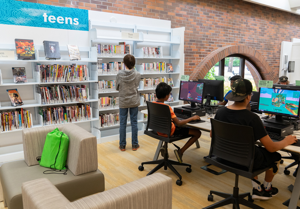 Patrons using public computers in the teen area at the Lake City Branch
