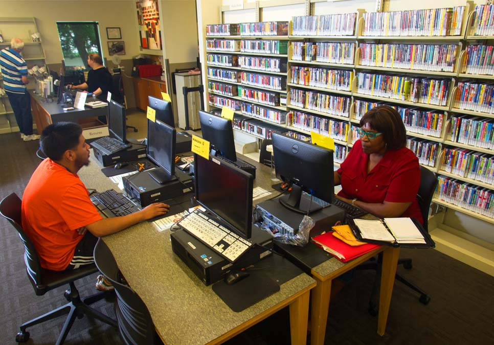 Library patrons using public computers at the Madrona-Sally Goldmark Branch