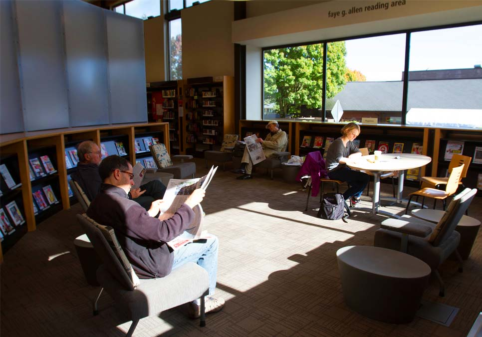 Library patrons in the Fay Allen Reading Room at the Northeast Branch