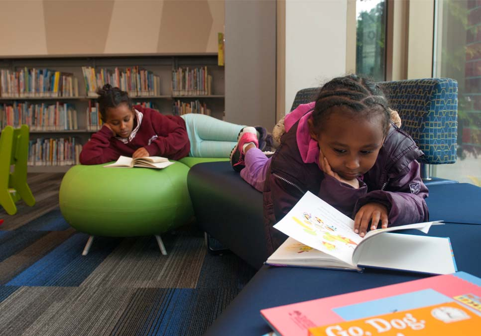 Children reading at the Rainier Beach Branch