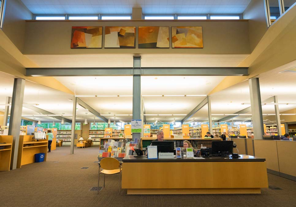 Library staff at service desk area at the Southwest Branch
