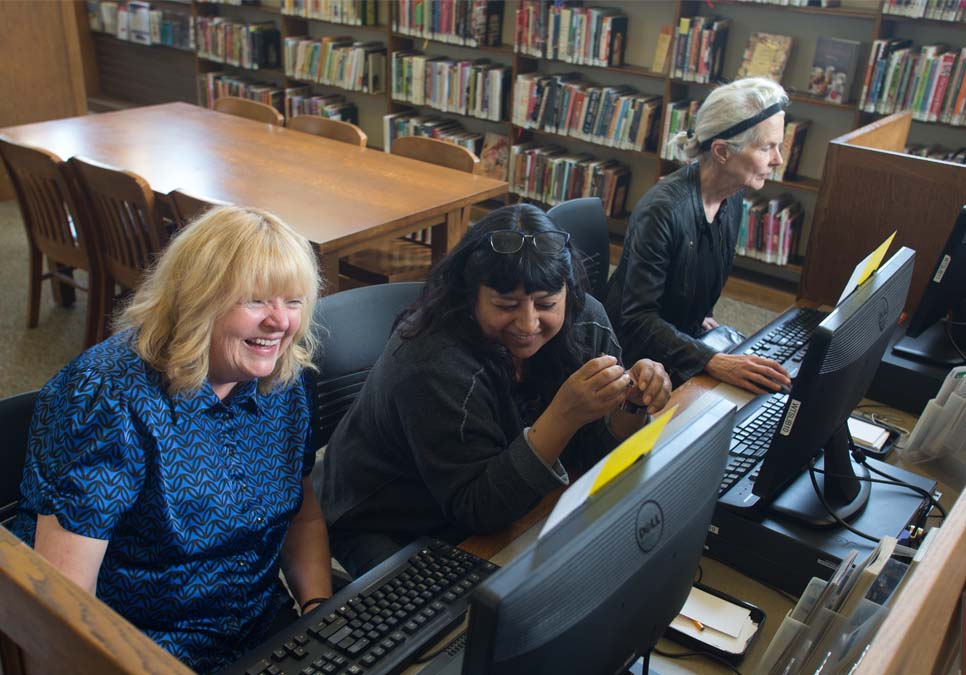 Library patrons using public computers at the West Seattle Branch