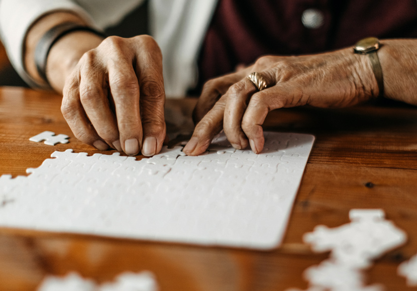 Older person working on a jigsaw puzzle