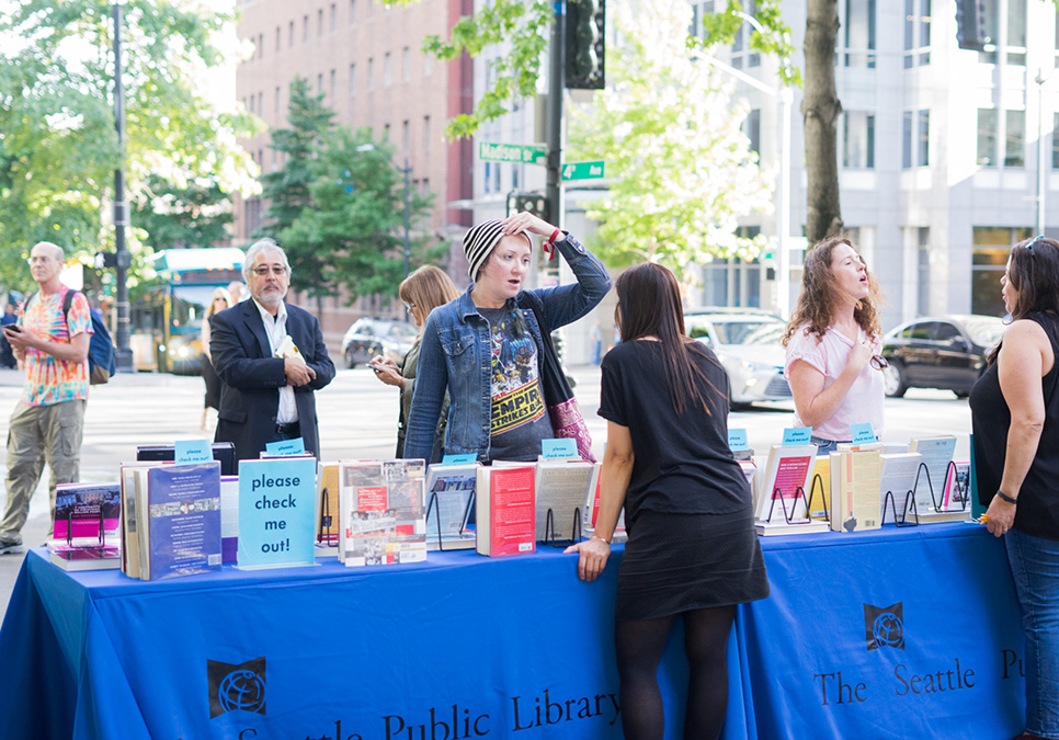 Library staff interacting with patron at art on the plaza event at the Central Library