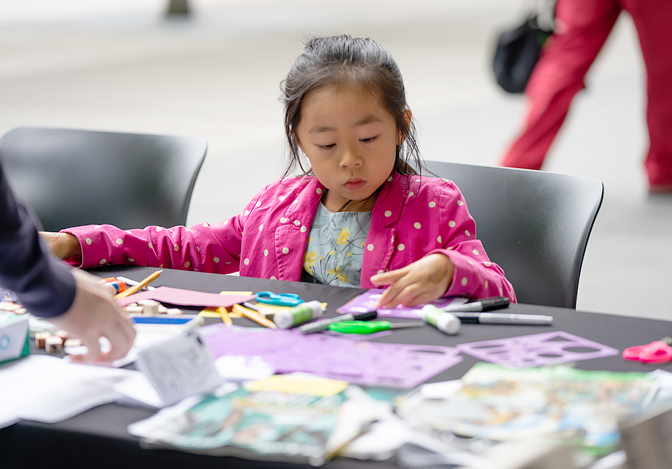 Patron crafting at art on the plaza event at the Central Library