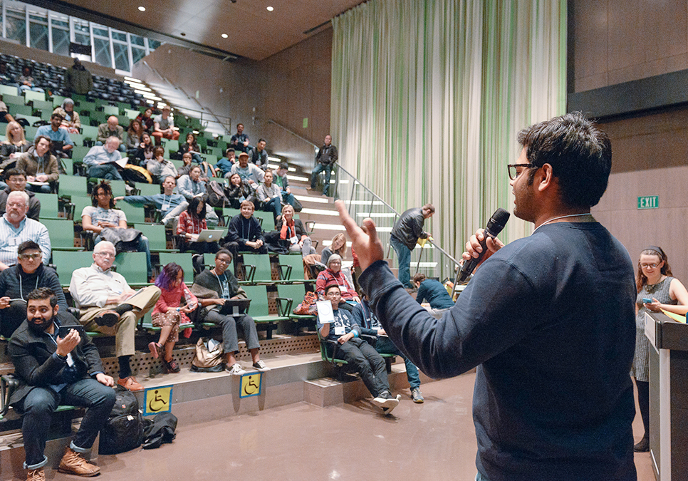 Public speaker addressing participants at Startup Weekend at the Central Library