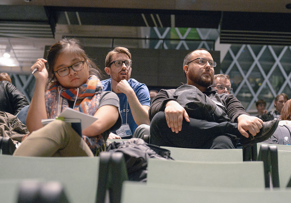Participants listening to public speaker at Startup Weekend at the Central Library