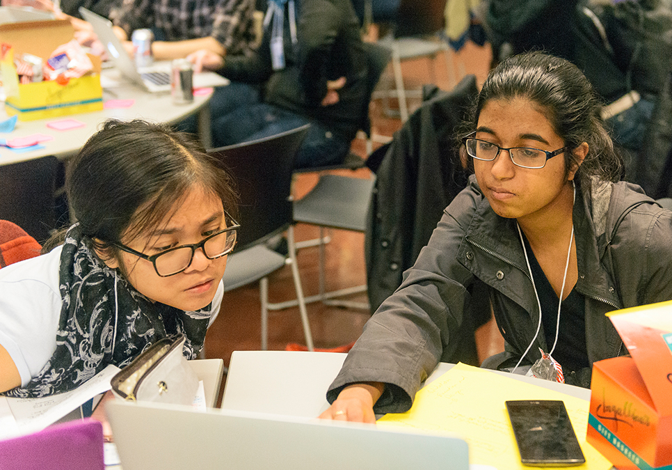 Participants collaborating at Startup Weekend at the Central Library