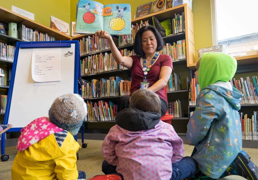 librarian reading story to children