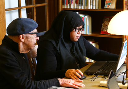 library staff helping patron with technology