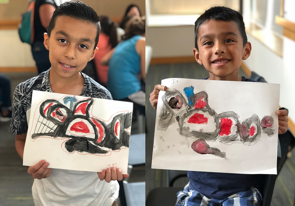 Young attendees showing paintings after attending Summer of Learning program at the High Point Branch
