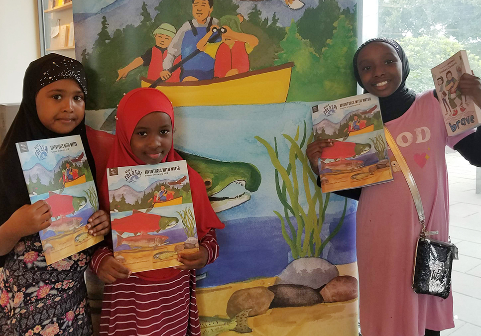 Young patrons at the High Point Branch posing with their Summer of Learning action guides